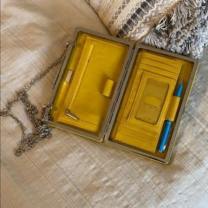Yellow tiny clutch purse/wallet.
